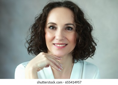beautiful middle age woman smiling to camera