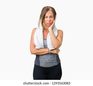 Beautiful middle age woman wearing sport clothes and a towel over isolated background thinking looking tired and bored with depression problems with crossed arms.