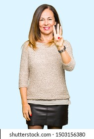 Beautiful middle age woman wearing fashion sweater showing and pointing up with fingers number three while smiling confident and happy.