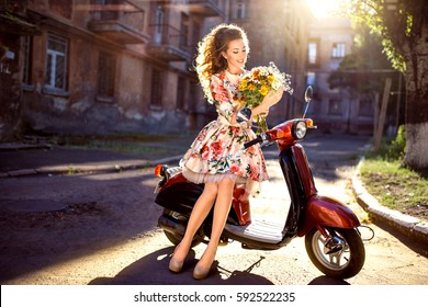 beautiful middle aged woman with flowers and curly hair.  Early spring morning