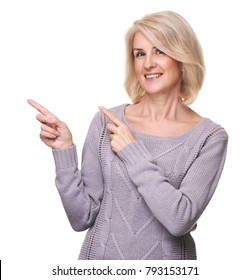 beautiful middle aged woman pointing to copy space. isolated on white. Beauty concept
