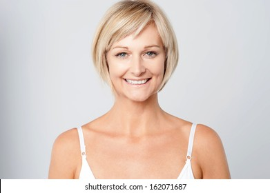 Beautiful middle aged woman smiling warmly
