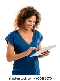 Beautiful middle aged woman working on a tablet