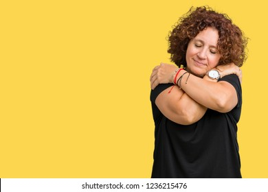 Beautiful middle ager senior woman over isolated background Hugging oneself happy and positive, smiling confident. Self love and self care