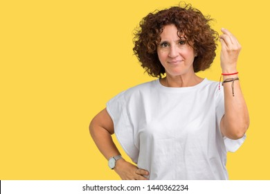 Beautiful middle ager senior woman wearing white t-shirt over isolated background Doing Italian gesture with hand and fingers confident expression