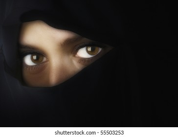 Beautiful Middle eastern woman in niqab traditional veil with glow filter effect