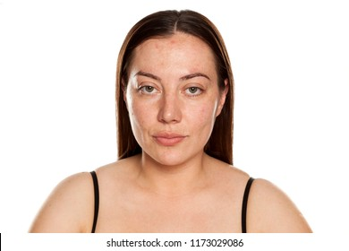 beautiful middle-aged serious woman without makeup on white background