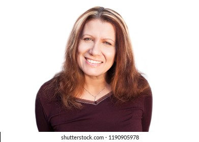A beautiful middle-aged woman cute smiles on a white background and rejoices that she is healthy and she does not hurt anything. Place for text. Isolated. She has white healthy teeth