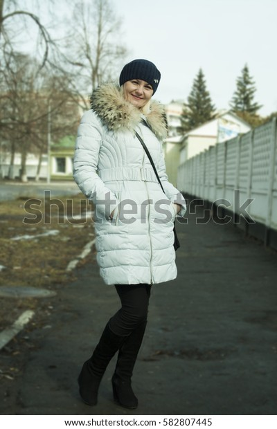 Beautiful middle-aged woman on the street in winter
