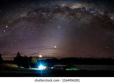 Beautiful milky way, starry night over the snow mountain at Lake Pukaki, New Zealand. High ISO Photography.