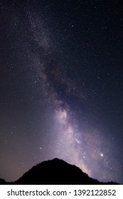 Beautiful milkyway and silhouette of mountain on a night sky with stars and space dust in universe