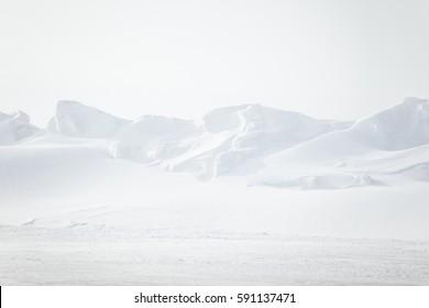 A beautiful, minimalist landscape of snowdrift in Norway. Clean, light, high key, decorative look.