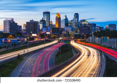 beautiful Minneapolis skyline with traffic light at night.