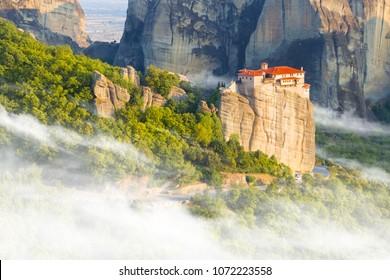 Beautiful misty layers of mountains near Meteora in Greece in sunlight. Greece