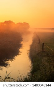 Beautiful misty morning in the Netherlands with a orange rising sun, picture taken in the province Overijssel