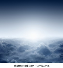 Beautiful misty sunrise from aerial view, view on clouds from above, bright sun