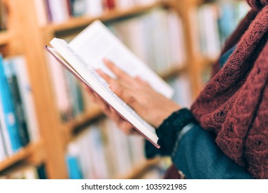 Beautiful mixed Asian woman in a book store/library
