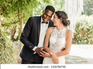 beautiful mixed couple of newlyweds
