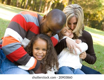 A beautiful mixed race family enjoying the park