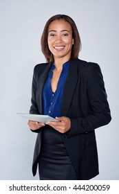 Beautiful mixed race woman holding an electronic tablet device, connected wirelessly business technology