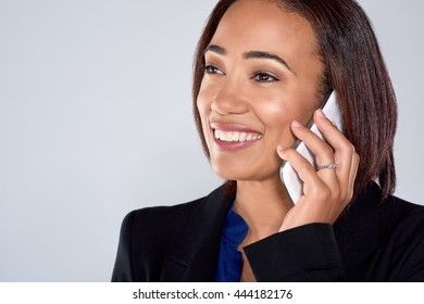beautiful mixed race woman talking smiling on her mobile cell phone smartphone