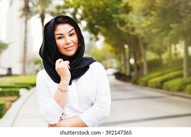 beautiful mixed raced muslim woman on a street of Dubai city