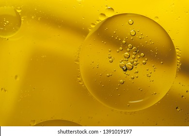Beautiful mixing water and oil on a yellow background.
