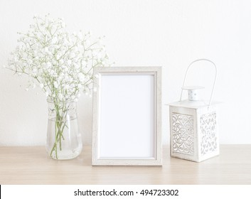 Beautiful Mockup With White Frame, White Baby's Breath Flowers And White Candle Holder