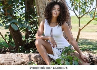Beautiful model afro american woman in a natural setting. Brazilian young woman.