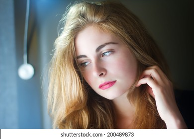 Beautiful Model Basking In The Natural Light Through Her Bedroom Window
