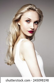 beautiful model with bright make-up (red lips) and blond hair