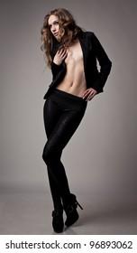 beautiful model dancing on grey background