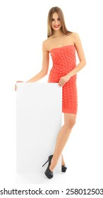 Beautiful model in dress with blank poster isolated on white