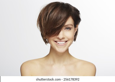 Beautiful model with fashionable hair cut, smiling