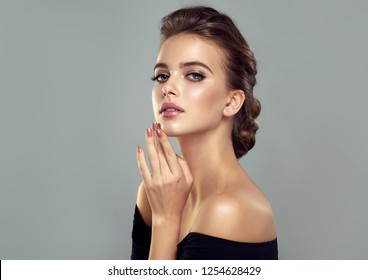 Beautiful model girl  with a charming smile  and  elegant hairstyle . Woman with fashion style makeup