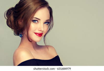 Beautiful model girl  with elegant hairstyle . Woman with fashion style makeup