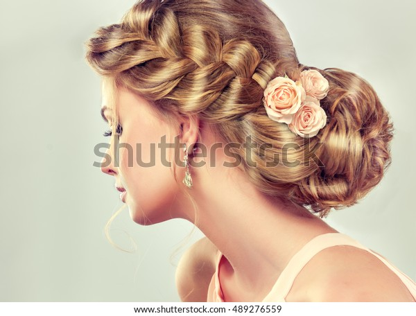 Beautiful model girl  with elegant hairstyle . Woman with fashion wedding hair