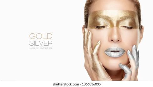 Schönes Mädchen-Gesicht mit hellen Make-up, glänzend Gold und silberne Lippenstift-Augen und Nägel. Macro Nahaufnahme eines Modeporträts einzeln auf Weiß mit Kopienraum für Text