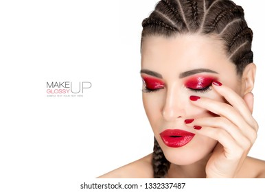 Beautiful model girl with glossy red eye shadow makeup, red lips and manicured red nails with stylish boxer braids hairstyle. High fashion portrait isolated on white with copy space for text