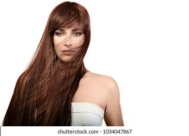 Beautiful model girl with gorgeous healthy long hair. Hair care and beauty concept. Beauty portrait isolated on white witn copy space