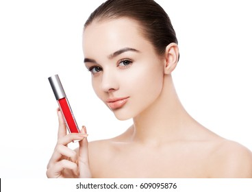 Beautiful model girl holding liquid red lipstick on white background