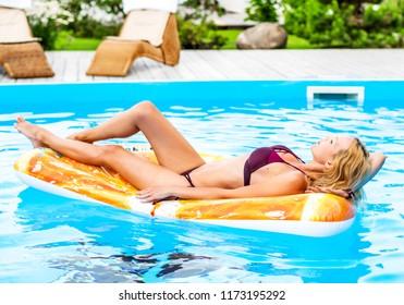 Beautiful model girl lies on shapes air mat