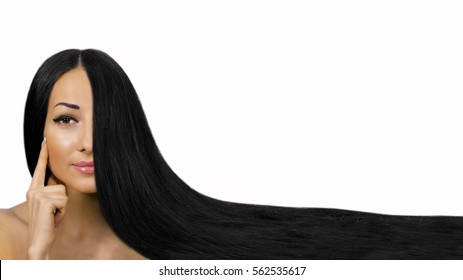 Beautiful model girl with shiny black straight long hair . Care and hair products .