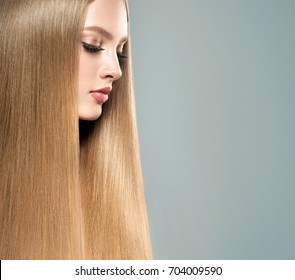 Beautiful model girl with shiny blonde  straight long  hair . Care and hair products . Keratin hair straightening