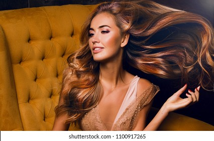 Beautiful model girl with shiny brown straight long hair . Care and hair products,Beautiful brunette girl in move with a perfectly smooth hair, and classic make-up. Beauty face. Sunflower,natural