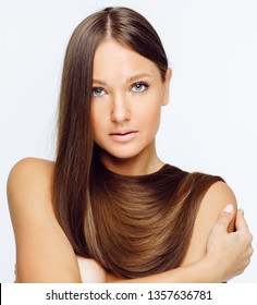 Beautiful model girl with shiny brown and straight long hair . Keratin straightening .