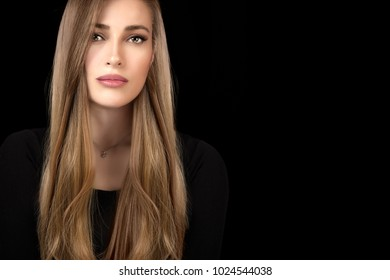 Beautiful model girl with shiny and healthy long hair with multi highlights hairstyle. Haircare and coloring products. Close up beauty portrait isolated on black with copy space