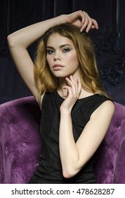Beautiful model girl wearing black dress in the studio