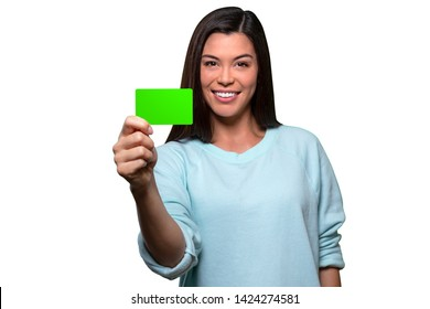 Beautiful model holding blank card, possibly credit, phone, gift, business, membership or ID card, isolated on white background