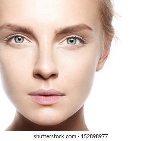 beautiful model lady with natural make-up and blonde hair studio fashion shot on white background, perfect skin